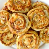 Cheesy French Pinwheels piled up on a plate