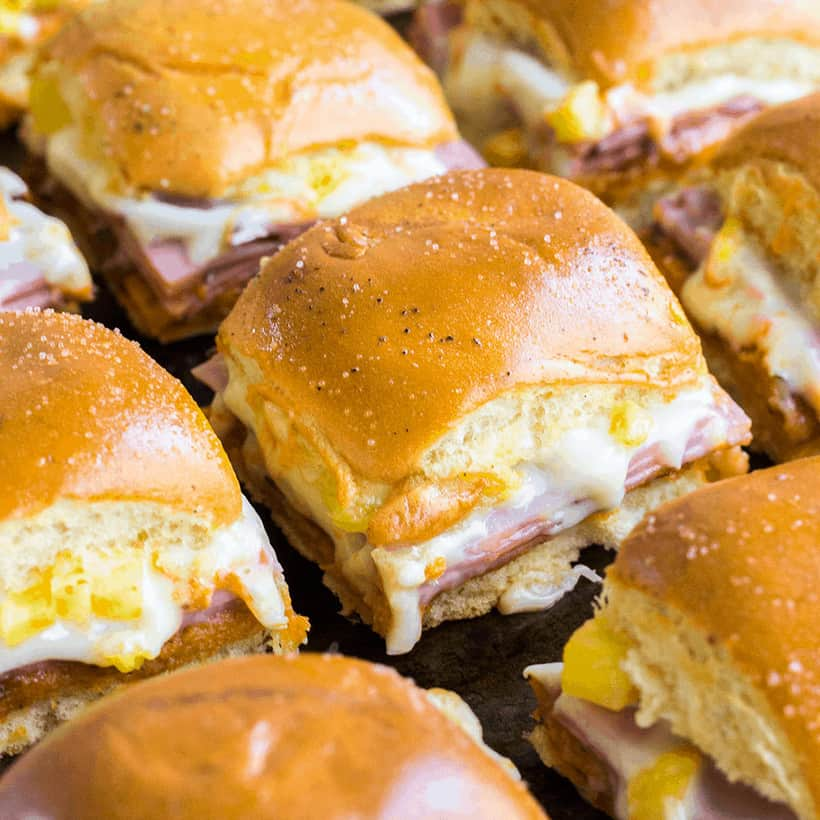 Your party isn't complete until you serve up these Hawaiian Pizza Sliders! Loaded with all your favorite pizza toppings, these sliders are easy to make and always a crowd favorite!