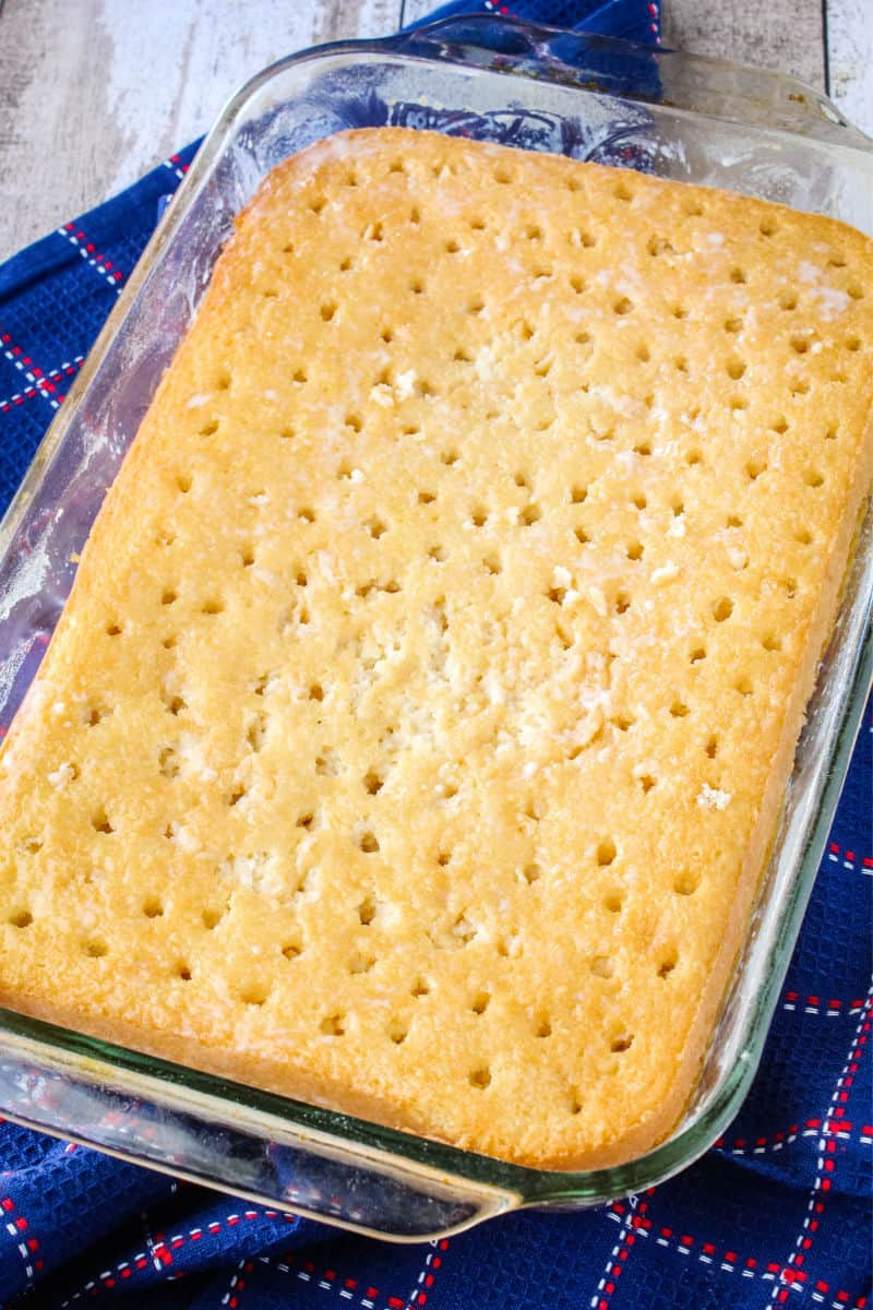 sheet cake with poles poked in the top and milk soaked in