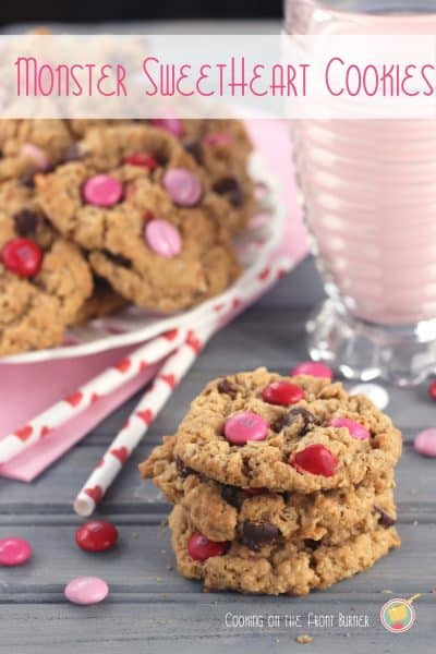 Monster Sweetheart Cookies are loaded with chocolate, peanut butter, oats & festive M&Ms for a Valentine's Day cookie you'll adore!