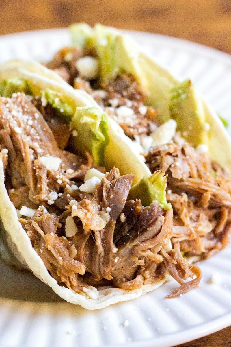 tacos loaded with Cuervo & Tecate Slow Cooker Carnitas