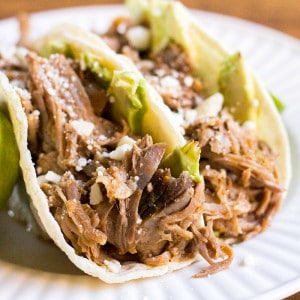 Cuervo & Tecate Slow Cooker Carnitas recipe is packed with so much flavor. This Mexican-style pork is super easy to make and perfect for Taco Tuesday!