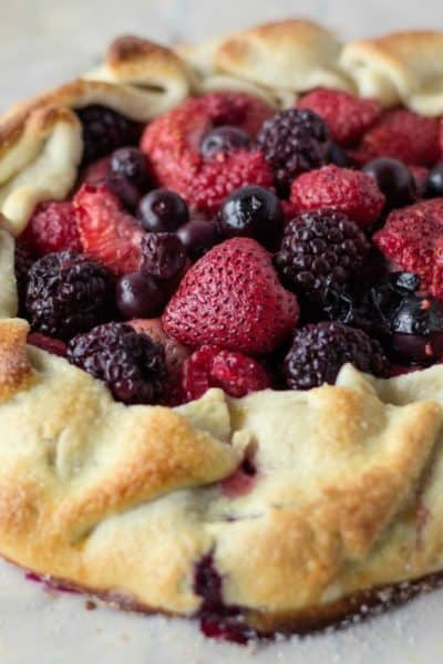 Rustic Berry Tart is a great way to use seasonal berries! You can make your own pie crust from scratch or keep it simple with a pre-made crust from the store!