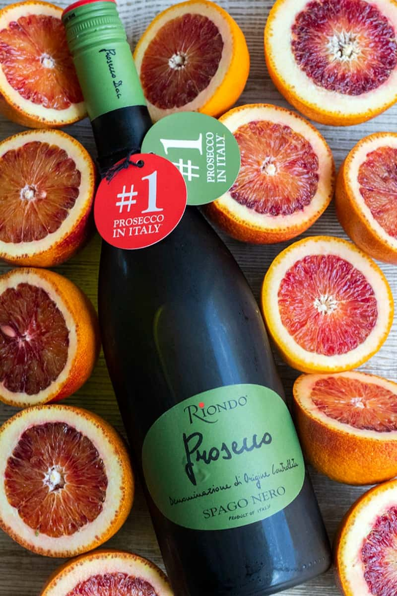 riondo prosecco bottle surrounded by blood orange halves