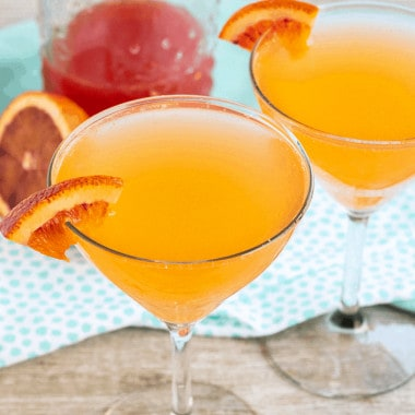 Sparkling Blood Orange Cocktail is a fruity & fizzy punch that's great for brunch or sipping with friends! A light & refreshing punch with a beautiful blush!