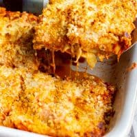 spatula lifting a serving of chicken parmesan lasagna