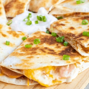 Cheesy and meaty, this easy Chipotle Polish Sausage Quesadilla is a hit with the whole family! Loaded with polish sausage, cabbage, bacon, and cheese each bite begs to be dipped in chipotle sour cream!