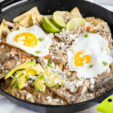 Start your morning off with a skillet of my Pork Chilaquiles Recipe! It's a savory nacho style dish that's satisfying, full of flavor & great for breakfast!