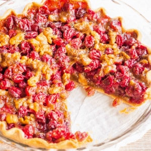 Cranberry Pie is a beautiful dessert that's crazy easy to make! The combination of tart cranberries and savory walnuts is perfect for the holidays!