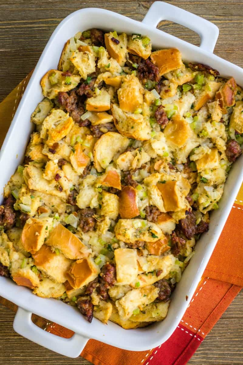 sausage stuffing a baking dish for thanksgiving dinner