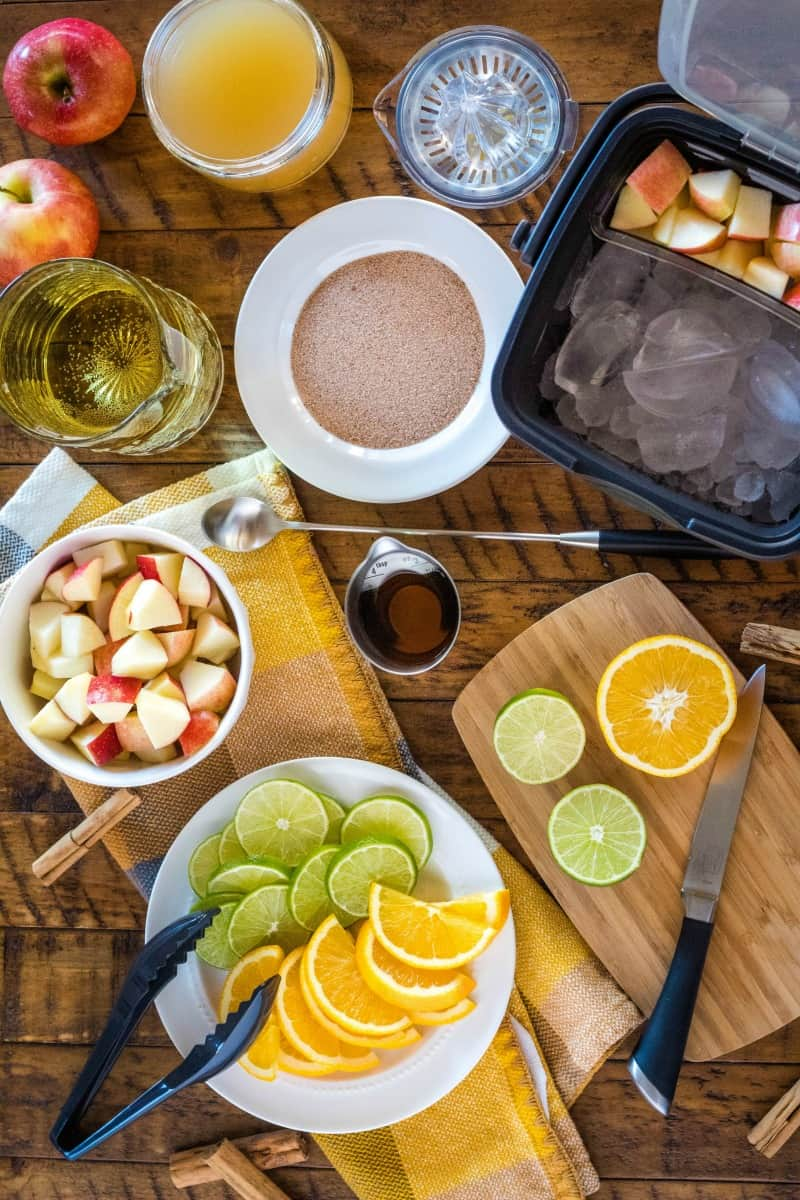 ingredient and OXO bar tools to make apple cider sangria