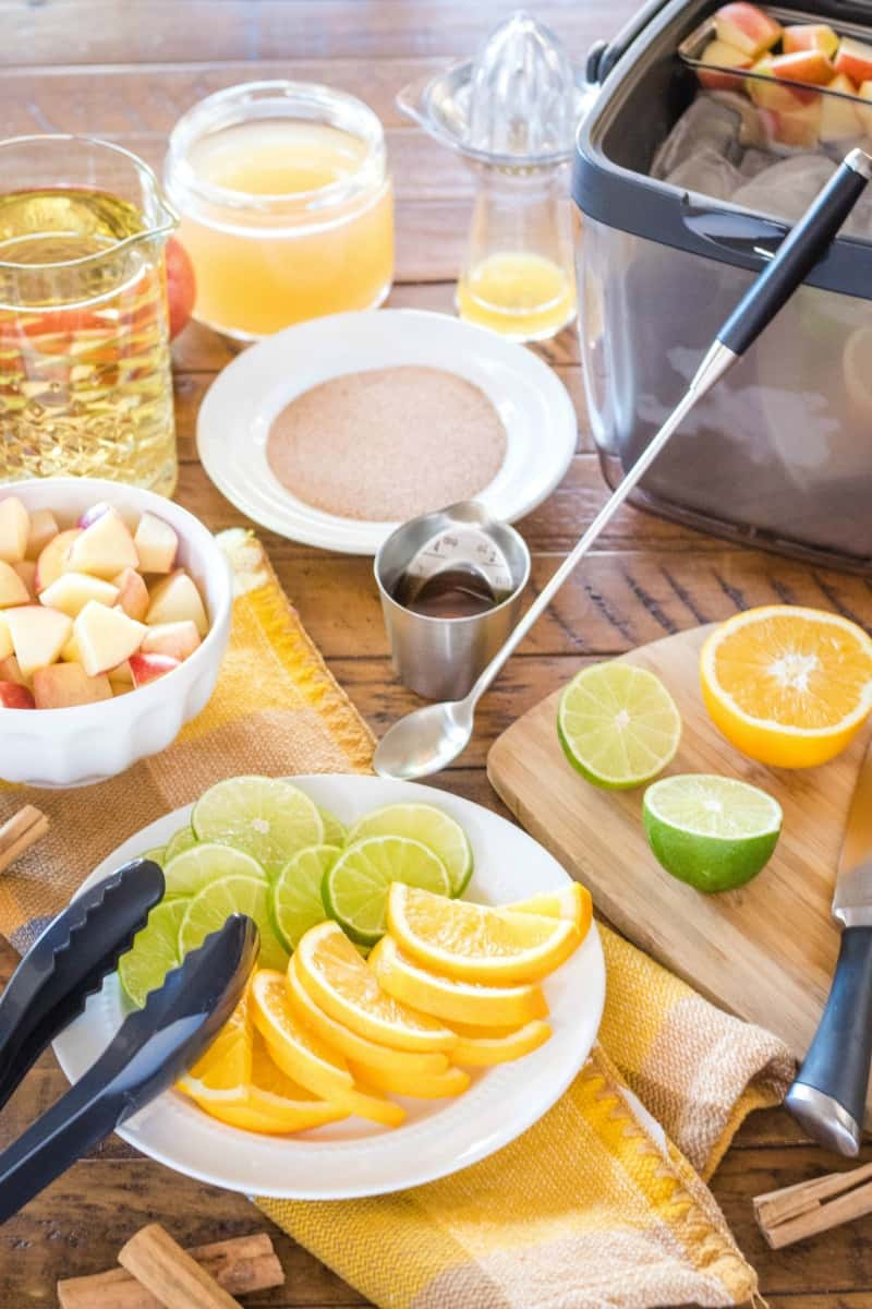 ingredients and OXO bar tools to make apple cider sangria