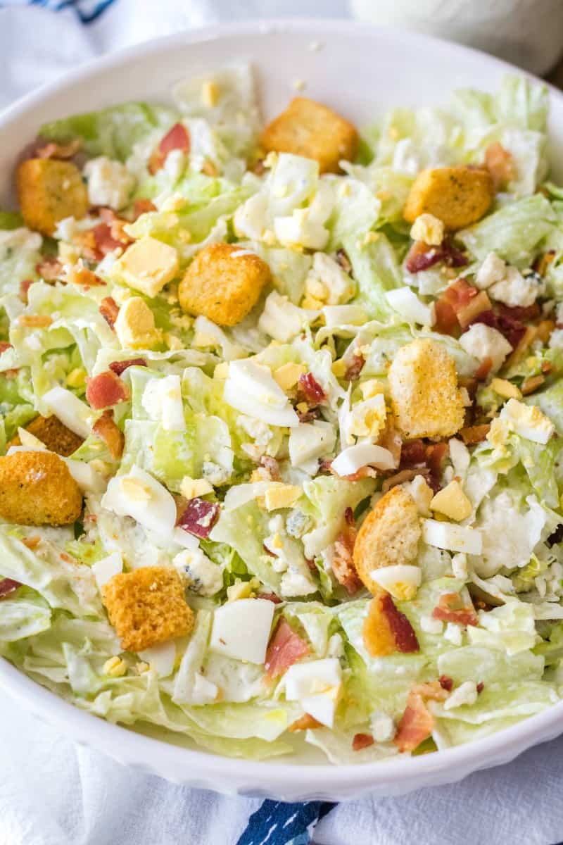 chopped wedge salad with blue cheese, bacon, and hard-boiled egg
