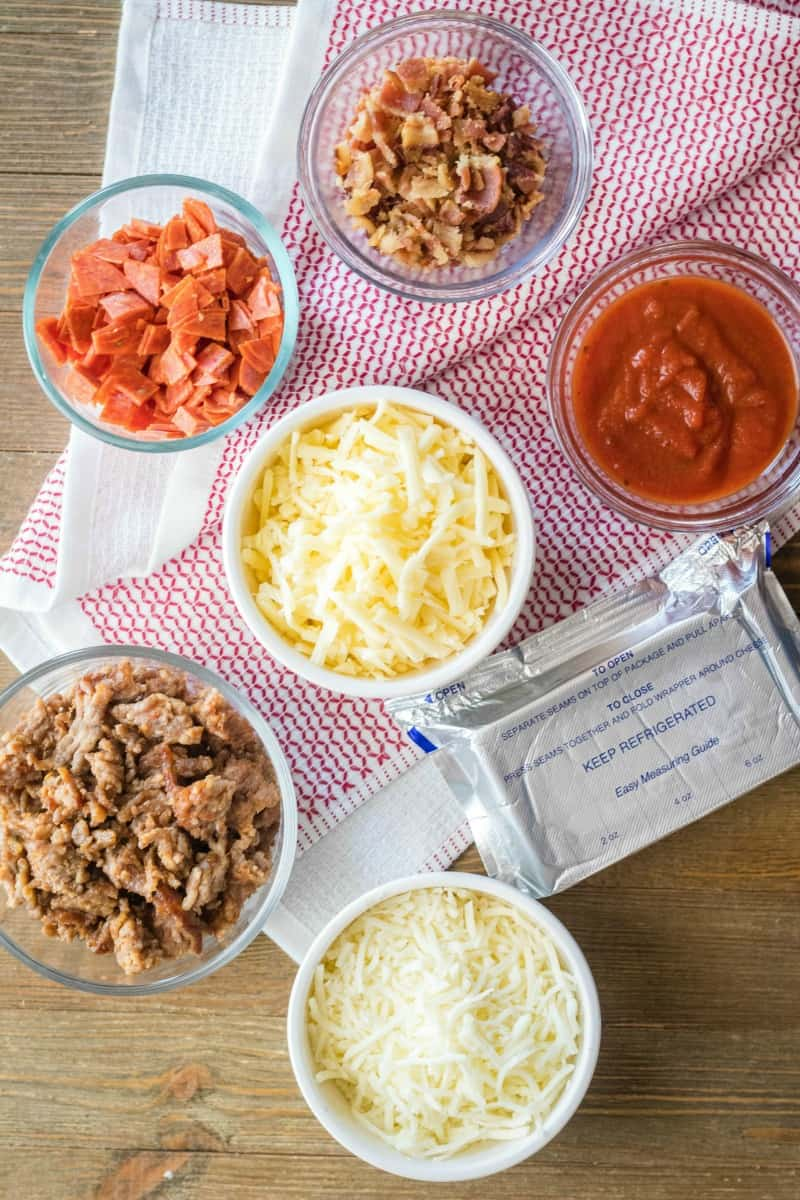 ingredients to make meat lover's crock pot pizza dip