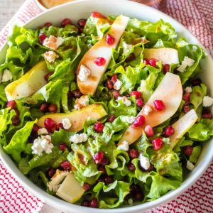 Craving a yummy salad? This easy Pomegranate and Pear Salad isdrizzled with pomegranate vinaigrette and studded with goat cheese. It's great all by itself or topped with grilled chicken!
