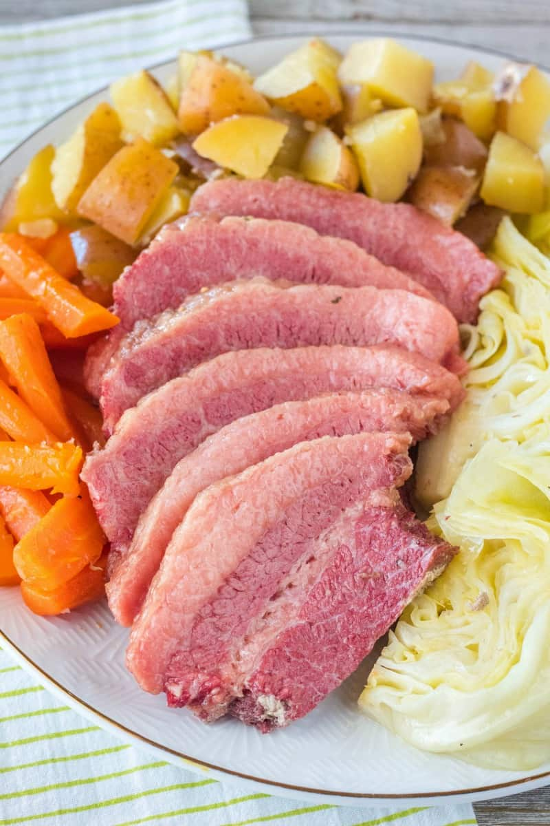 corned beef and cabbage, carrots, and potatoes on a serving platter