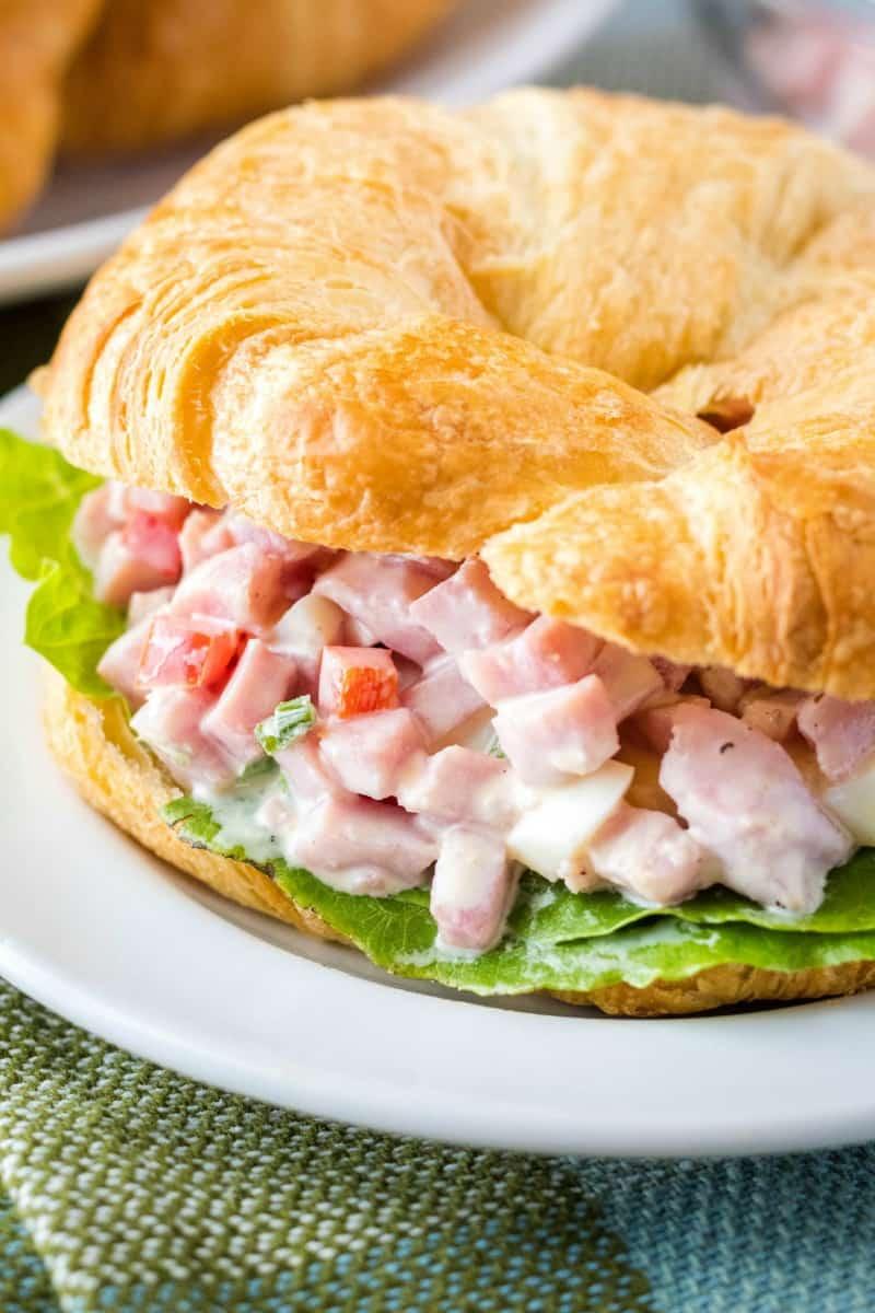 close up of ham salad sandwich on croissant