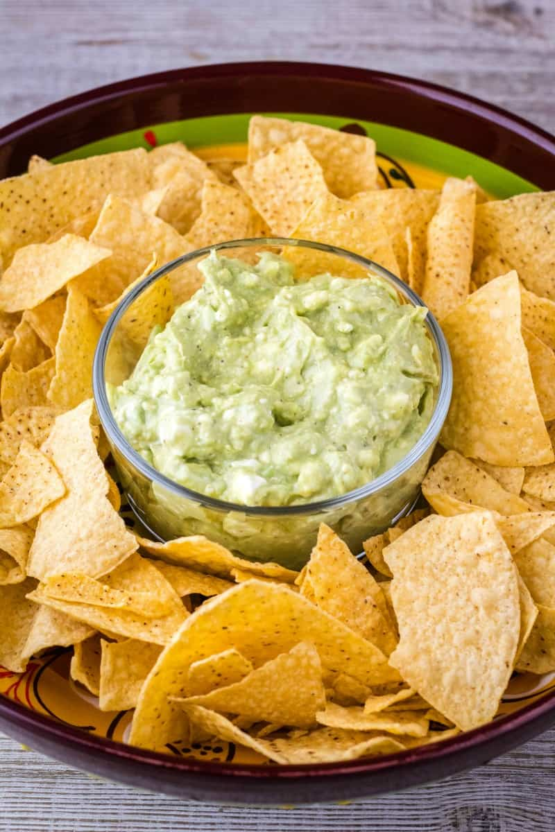 guacamole dip in a bowl with chips