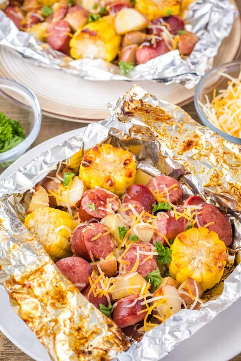 cheesy sausage, potato & corn foil packet opened after grilling