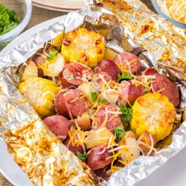 This Smoked Sausage and Potatoes Foil Packet Meal is a simple recipe that's ready in under 30 minutes with practically no cleanup!