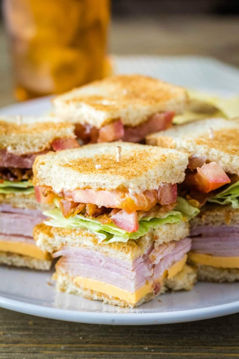club sandwich cut in quarters and secured with toothpicks