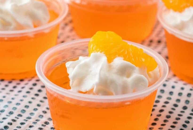 Creamsicle Orange Jello Shots are a delicious combination of fruity orange jello and creamy whipped vodka for a perfect party shot!