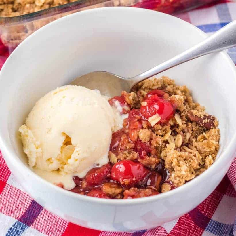 You need this Easy Cherry Crisp recipe in your life! Only 3 steps to dessert bliss! Add a scoop of vanilla ice cream for the ultimate summer treat!