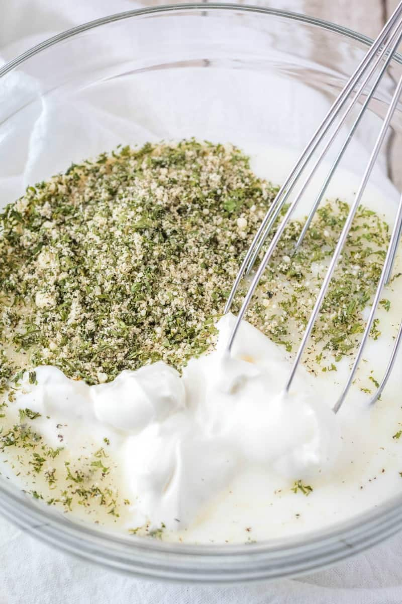 ranch mix and dressing ingredients in a mixing bowl
