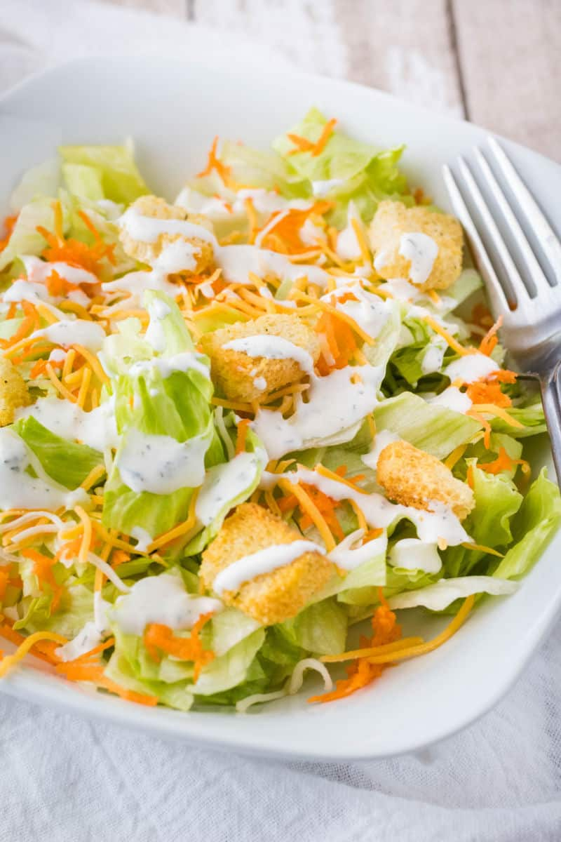 ranch dressing drizzled on a salad