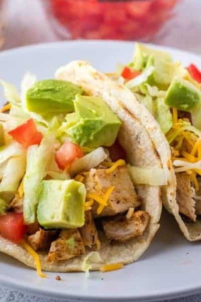 Easy Seasoned Chicken Tacos are ready in 20 minutes. Perfect for busy weeknights! Top them any way you like and watch everyone clean their plates!