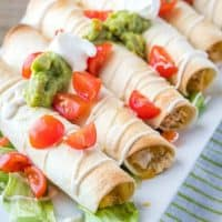 Get dinner on the table in a hurry with Creamy Baked Chicken Flautas! Cheesy chicken filling is loaded with Mexican spices for a family dinner favorite!