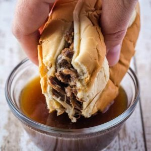 Crock Pot French Dip sandwiches are a favorite at our house! Set and forget, and perfect for feeding a crowd! Serve with or without onions for a dinner win!