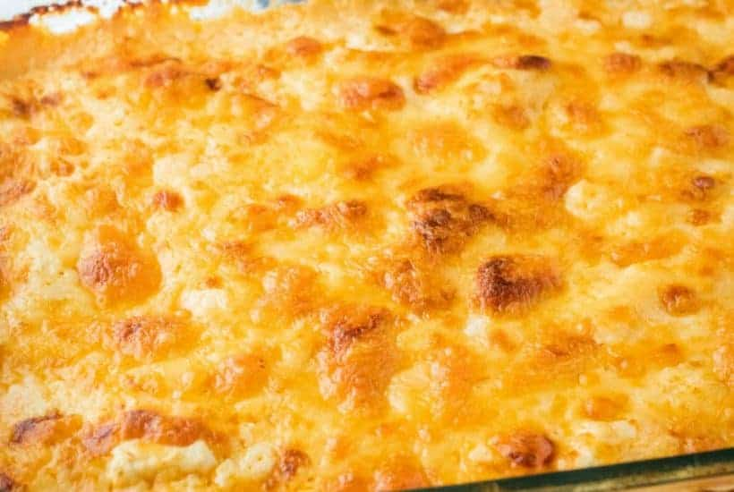 My Mom's Famous Buffalo Chicken Dip is layers of spicy dip bliss! Easy to make, and anytime I go to a party our friends ask me to bring it!