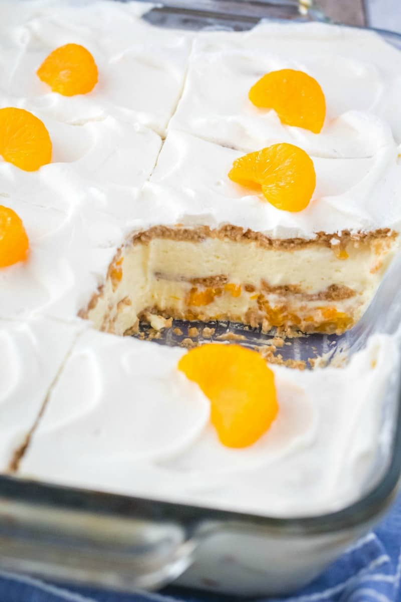 no bake oange ice box cake with a slice taken out