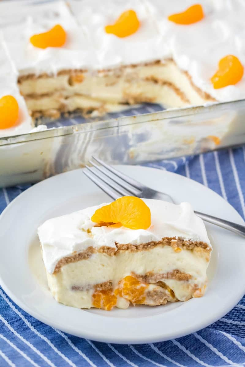 slice of no bake orange icebox cake on a plate with a fork