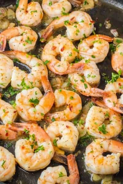 Easy Shrimp Scampi is a classic! Succulent shrimp swimming in garlic butter sauce is ready in about 20 minutes and will leave you wanting to lick your plate!