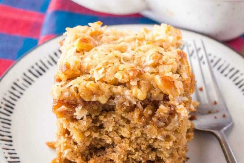 When it comes to comforting desserts, this Old-Fashioned Oatmeal Cake is everything! Topped with broiled coconut and nuts, each bite is a hug for your mouth!