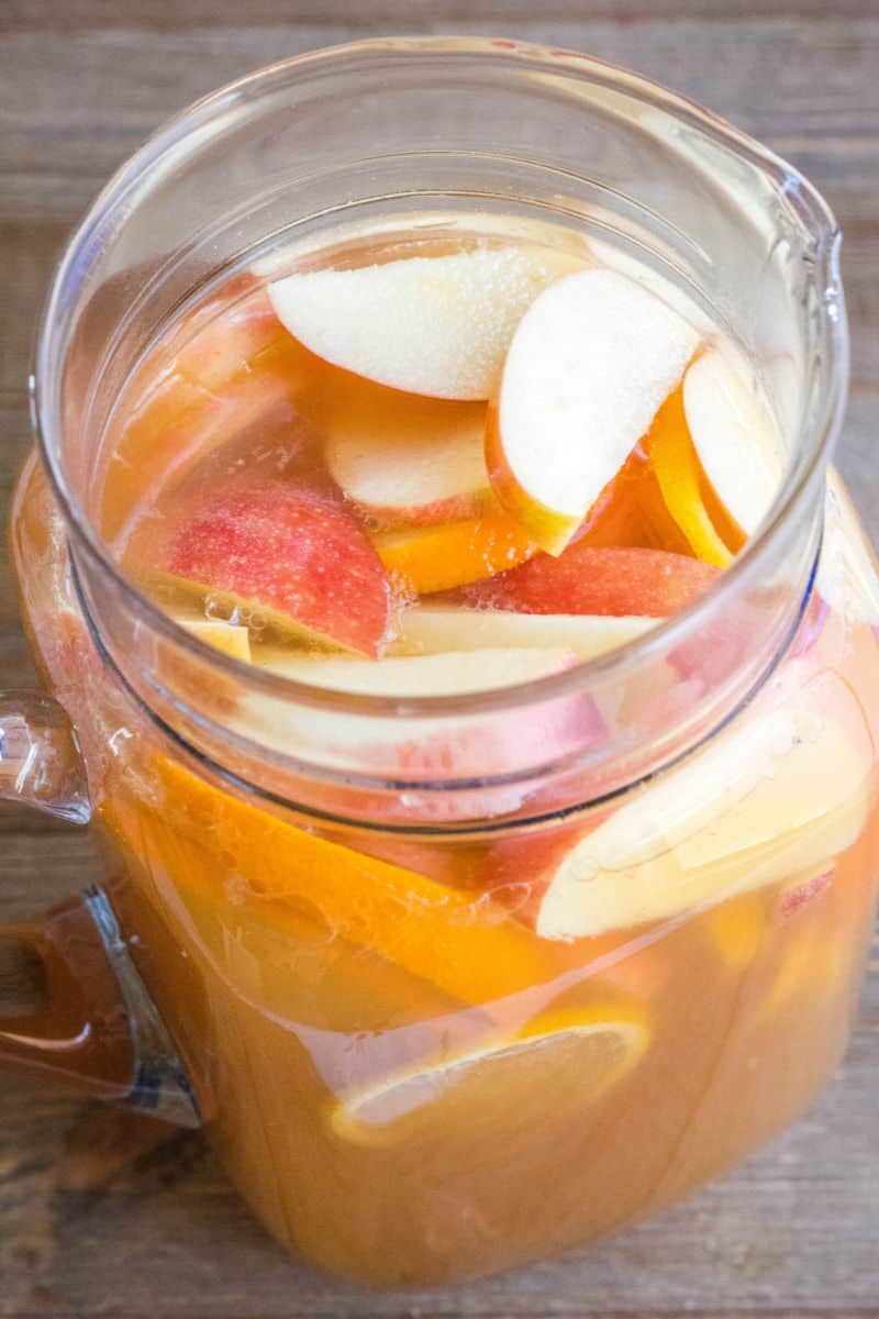 whiskey punch with apples and oranges in a pitcher