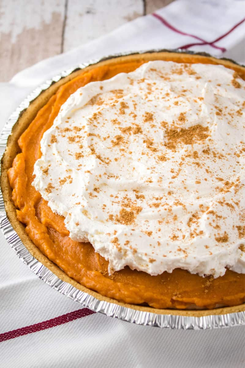 no back pumpkin pie with whipped topping and chai spice on top