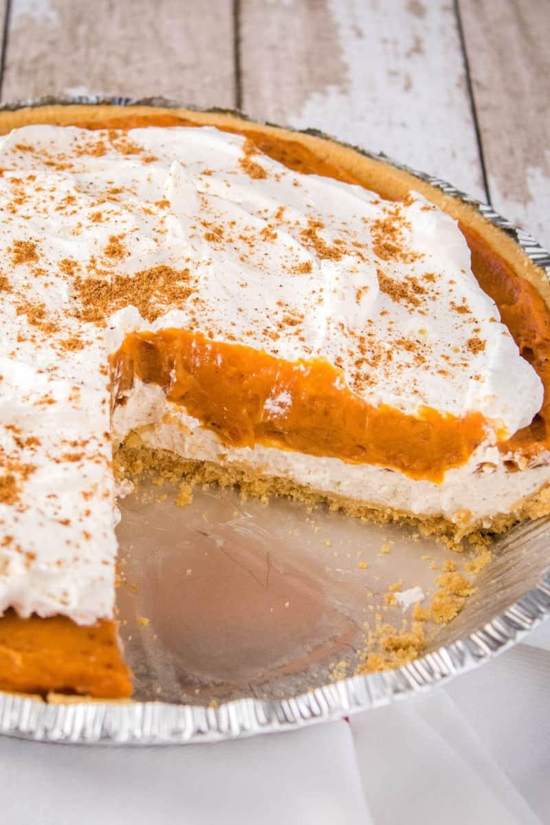 cream cheese pumpkin pie with slices taken out to show center