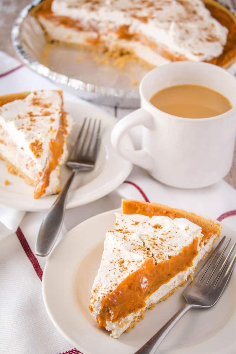 slices of double layer pumpkin pie on dessert plates