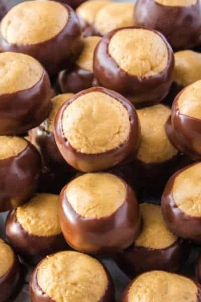 This Buckeye Recipe is a tradition in our house every November. Peanut butter balls are dipped on chocolate to look like a Buckey nut & they're O-H so good!
