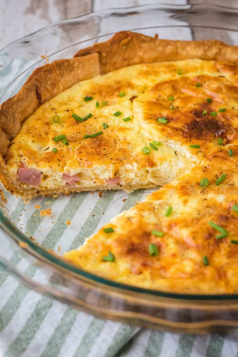 ham cheese quiche with a slice taken out