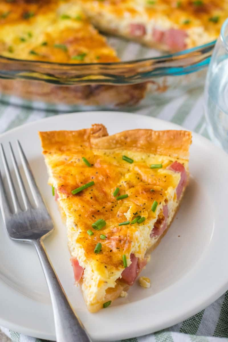 slce of quiche on a plate with a fork
