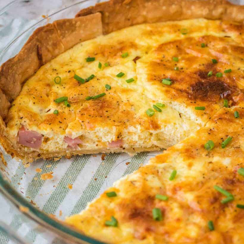 Brunch is a snap when you make this Easy Ham and Cheese Quiche! Simply prep your pie crust, pour in the filling and bake. It's practically fool-proof!
