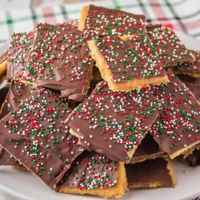 Christmas Crack takes just minutes to make and is completely addicting! Add it to your holiday dessert plates and watch everyone's eyes light up!