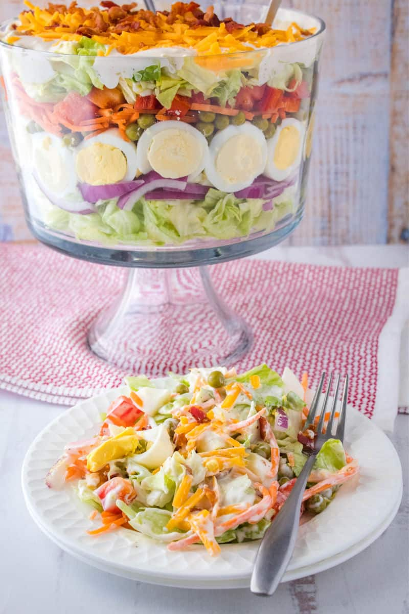 seven layer salad on a salad plate with a fork