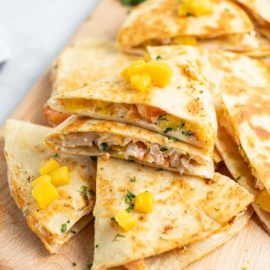 Mango & Shrimp Quesadillas are crazy good and fly off the plate! Make them with or without cilantro for a dinner win the whole family will love!