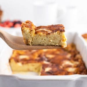 square image of a piece of french toast casserole on a spatula