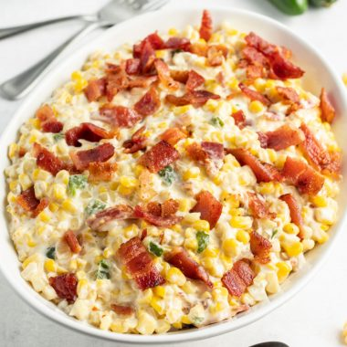 serving bowl of creamed corn topped with chopped bacon